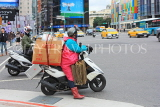 Taiwan, TAIPEI, Ximending Shopping District, moped rider with heavy lead, TAW1309JPL