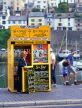 UK, Devon, BRIXHAM, town centre, ticket booth selling fishing trips, DEV394JPL