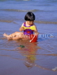 UK, Devon, PAIGNTON, child (toddler) on beach, playing with bucket and spade, DEV361JPL