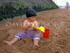 UK, Devon, PAIGNTON, child (toddler) on beach, playing with bucket and spade, DEV368JPL