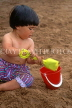 UK, Devon, PAIGNTON, child (toddler) on beach, playing with bucket and spade, DEV537JPL