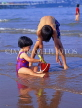 UK, Devon, PAIGNTON, two children on beach, playing with bucket and spade, DEV365JPL