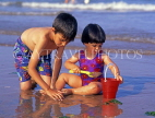 UK, Devon, PAIGNTON, two children on beach, playing with bucket and spade, DEV366JPL