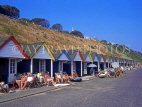 UK, Dorset, BOURNEMOUTH, beach cabins with holidaymakers, DOR723JPL