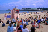 UK, Dorset, WEYMOUTH, beach with holidaymakers watching 'Punch & Judy' show, UK4246JPL