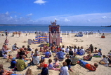 UK, Dorset, WEYMOUTH, beach with holidaymakers watching 'Punch & Judy' show, UK5106JPL