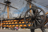 UK, Hampshire, PORTSMOUTH, Historic Dockyard, HMS Victory and bronze field gun statue, UK6574JPL
