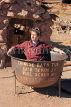 USA, California, Calico Ghost Town, old Chinese bath tub, and tourist sitting in it, US4849JPL