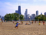 USA, Illinois, CHICAGO, skyline, and people playing volleyball, North Avenue Beach, CHI807JPL
