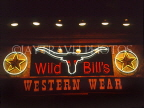 USA, Texas, DALLAS, Wild Bill's Western Wear shop, neon lit sign, DAL94JPL