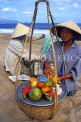 VIETNAM, Nha Trang, fruit vendor on beach, VT169JPL