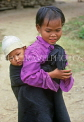 VIETNAM, Nha Trang, girl carrying little brother on back, VT477JPL
