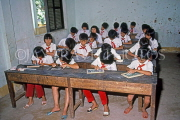 VIETNAM, Nha Trang, school children in classroom, writing on slate, VT476JPL