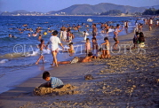 VIETNAM, Nha Trang coast, children playing on beach, VT365JPL