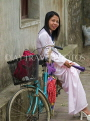 VIETNAM, Ninh Binh, woman in traditional dress with bicycle, VT518JPL