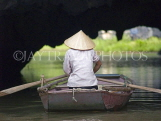 VIETNAM, Ninh Binh, woman rowing boat on Tam Coc River, VT527JPL
