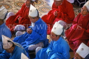 VIETNAM, Tay Ninh, Cao Dai Holy See temple, monks  praying, VT300JPL