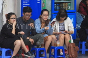 Vietnam, HANOI, Old Quarter, young people socialising at coffee shop, VT1333JPL
